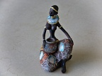 Statuette of African woman sitting
