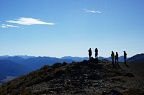 Silhouette of trampers on Mt Bruce
