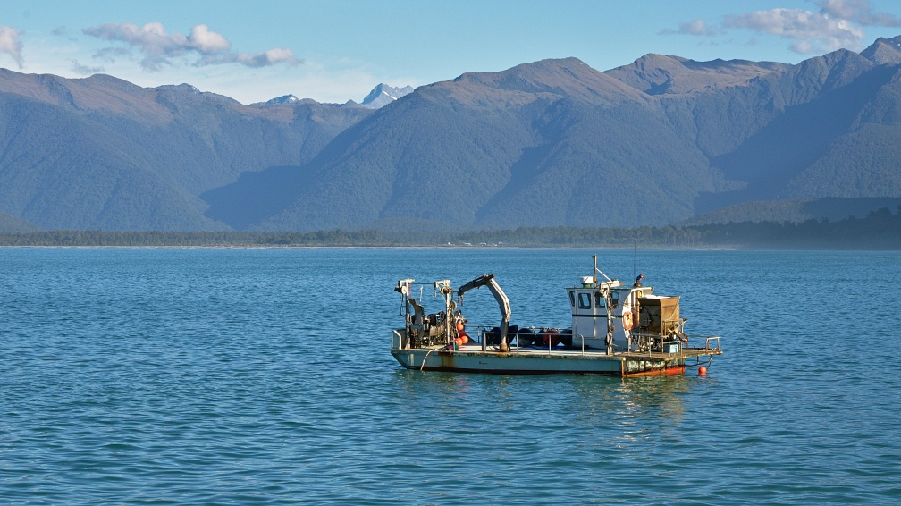 Fishing boat and West Coast mountains