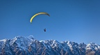Paraglider above Remarkables range