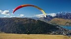 Tandem paraglider ready to take off