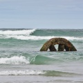 Flywheel from the SS Victory, in the surf at low tide