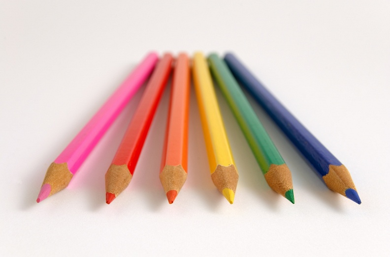 Colour pencils evenly spread on flat surface