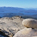 Granite rock formation on Mount Titiroa, Lake Manapouri in backg