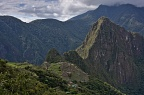 Machu Picchu city ruins and Huayna Picchu ruins and mountain