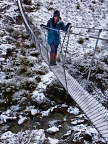 Tramper on wire bridge over Morgan Stream