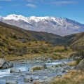 Cameron River and snowy mountains in distance