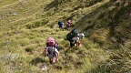 Climbing steep tussock slope