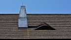 Shingle roof and white chimney