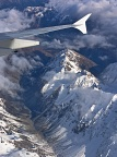 Airplane wing and mountain ridge and valley