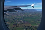 Airplane wing and Canterbury Plains through the window