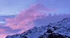 Pinky cloud above snowy mountain tops