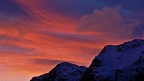 Dramatic red sky in Winter mountains