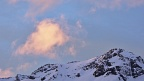 Pinky cloud formation above a snowy mountain top