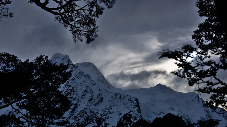 Dramatic stormy clouds above snowy mountains
