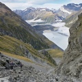 Trampers in rocky gully, Hooker Lake, and Sealy Range