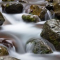 Creek with boulders and silky smooth water