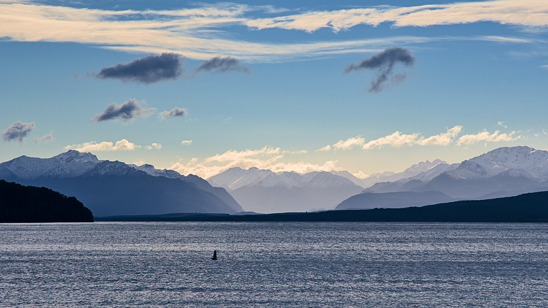 Lake Te Anau and snowy Fiordland mountains