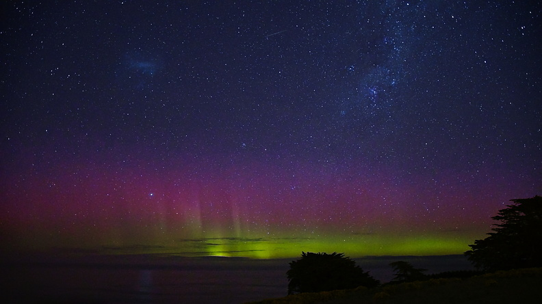 Purple and green aurora australis